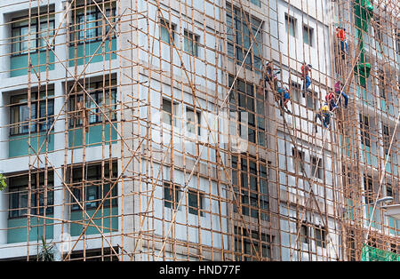 At work, Construction workers in Bamboo Scaffolding,Hong Kong, China - Stock Photo
