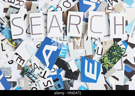 Search word cutout from paper on cut letters background - Stock Photo