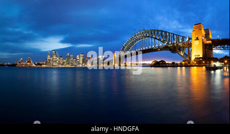 Sydney Opera House and Harbour Bridge at Dusk, Sydney, Australia - Stock Photo