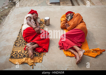 Sadhus sleeping, in the ghats of Ganges river, Varanasi, Uttar Pradesh, India. - Stock Photo