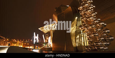 Night view of the Guggenheim Museum Bilbao, the museum of modern and contemporary art designed by architect Frank - Stock Photo