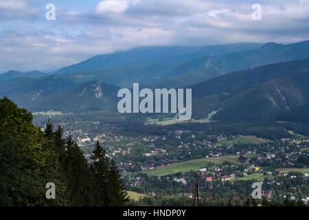 Tatra Mountains and Zakopane town at the foot the mountains - Stock Photo