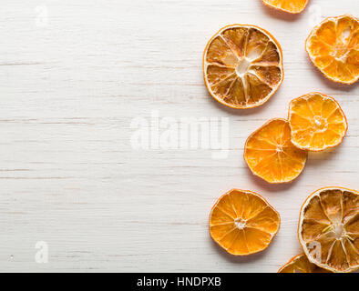 dried orange slices arranged Sliced citrus. Space for text. - Stock Photo