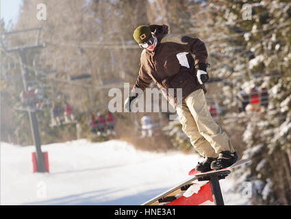 snowboarder on a rail - Stock Photo