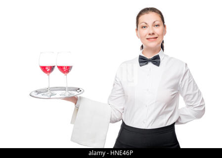 portrait of a beautiful waitress with two glasses of red wine on a tray on a white background - Stock Photo