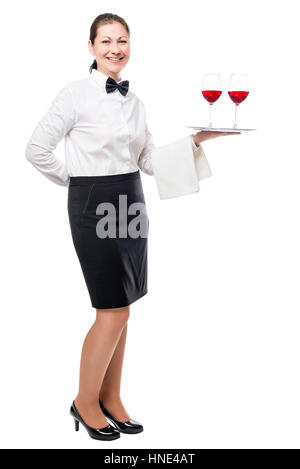 Portrait of a young waitress with glasses of red wine on a tray isolated in full length - Stock Photo