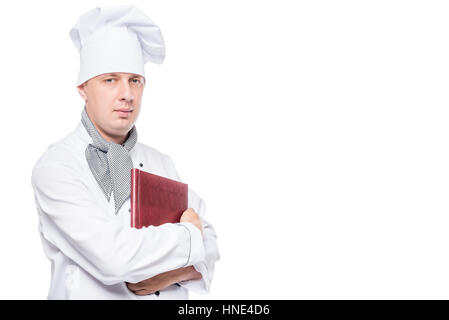 cute chef with a menu in his hands posing on a white background - Stock Photo