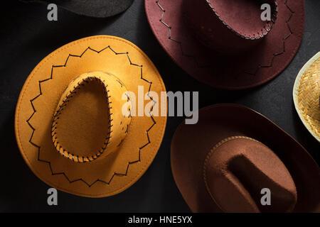 cowboy hat on  black background - Stock Photo