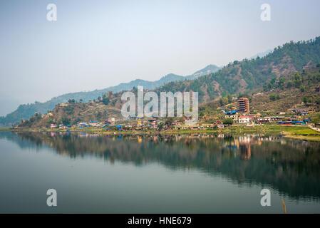 View of Phewa Lake in Pokhara Valley, Kaski, Nepal. - Stock Photo