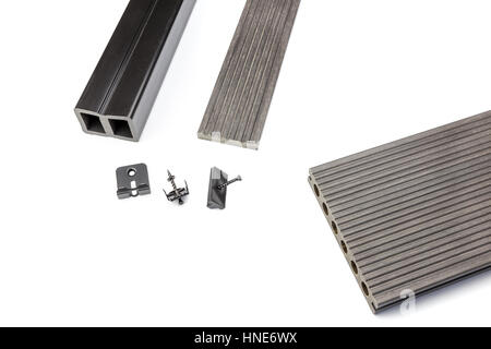 Grey composite decking plank with mounting material - Stock Photo