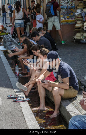 Cooling off in the Freiburg runnels, Freiburg im Breisgau, Germany - Stock Photo