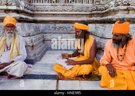 Sadhus (holy men), in Jagdish Temple,Udaipur, Rajasthan, india - Stock Photo