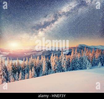 starry sky in winter snowy night. Carpathians, Ukraine, Europe - Stock Photo