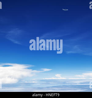 Oncoming flight traffic in mid air. Aircraft flying above earth, beautiful white cloud. Clear blue sky, aerial view - Stock Photo