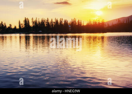 Sunset over the lake. Majestic mountain  in National Park Hi - Stock Photo