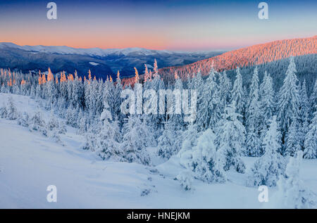 Fantastic winter landscape in the mountains. Magical sunset in a - Stock Photo