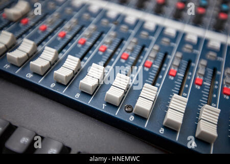 Close-up of sound mixing equipment in television studio - Stock Photo