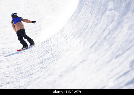 Snowboarder in a half pipe - Stock Photo