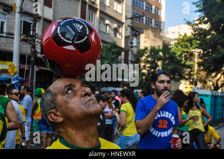 Spectators awaiting a Brazil game during the 2014 World Cup - Stock Photo