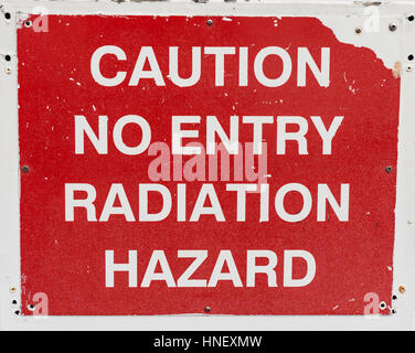 Lettering Caution no entry radiation hazard, warning sign against radiation - Stock Photo