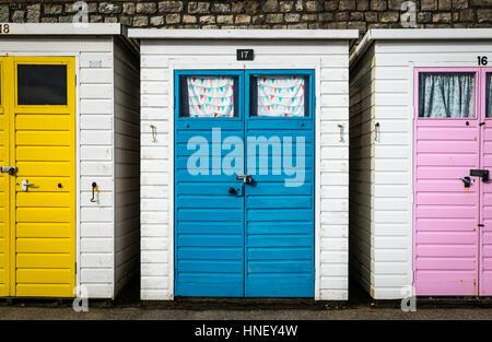 Colourful Beach Huts on Lyme Regis beach in Dorset - Stock Photo