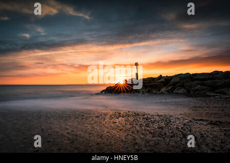 Sunset on Southbourne Beach in Dorset - Stock Photo