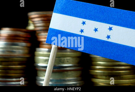 Honduras flag waving with stack of money coins macro - Stock Photo