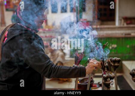 Incense offering, in Hazrat Nizamuddin Dargah, Delhi, India - Stock Photo