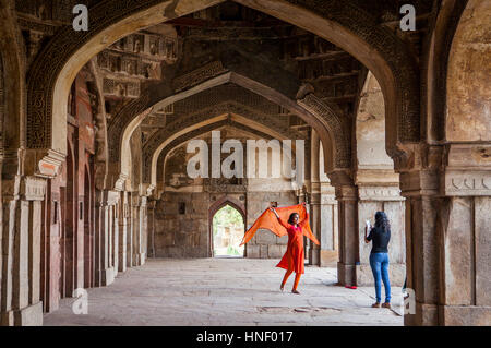 Friends, in Bara Gumbad, Lodi Garden, New Delhi, India - Stock Photo