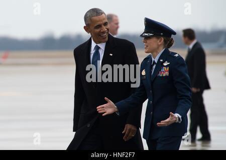 Former U.S. President Barack Obama is greeted by U.S. Air Force Vice Commander Julie Grundahl on the flightline - Stock Photo
