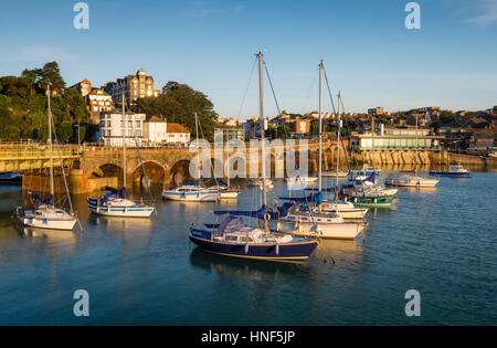 Fishing boats in Folkestone Harbour, Kent with the Folkestone Harbour viaduct and Rocksalt restaurant bathed in - Stock Photo