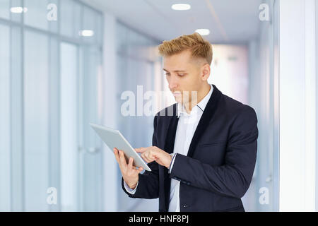 A man in  suit works with the tablet  office corridor - Stock Photo