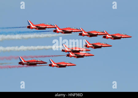 The Red Arrows arriving from crowd rear at the start of a display during a Duxford Airshow. - Stock Photo