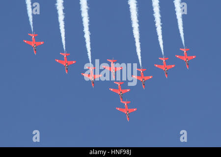 The Royal Air Force Aerobatic Team, The Red Arrows pulling up from a dive during a display at a Duxford Airshow. - Stock Photo