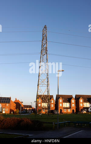 electricity transmission tower cutting through housing estate in kirkby liverpool uk - Stock Photo