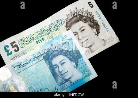 New polymer 5 pound note next to the old paper note - Stock Photo