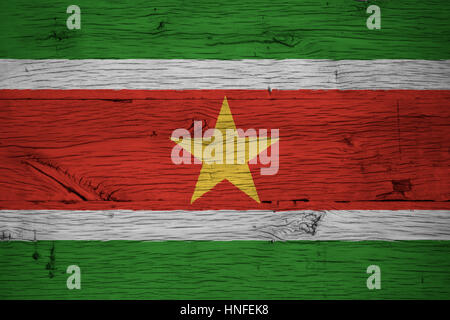 Suriname national flag painted on old oak wood. Painting is colorful on planks of old train carriage. - Stock Photo