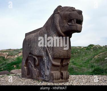 Colossal basalt lion. Ain Dara. Archaeological site. Syro-Hittite. Iron Age. 1300-740 BC. - Stock Photo
