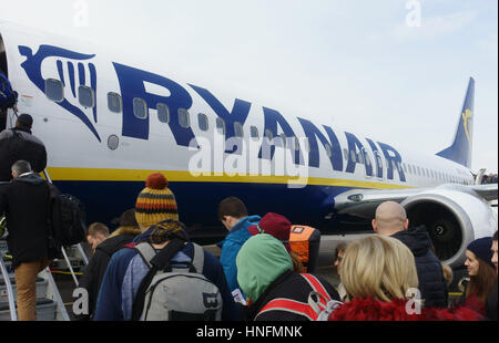 passengers queuing on the runway to board a Ryanair flight - Stock Photo