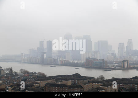 London, UK. 12th February, 2017. UK Weather: Fog over London and Canary Wharf business park buildings © Guy Corbishley/Alamy - Stock Photo