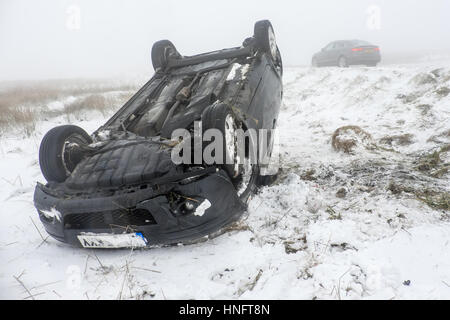 RTA ( car crash )  in snow and ice on the A537 Cat and Fiddle road between Buxton and Macclesfield - Stock Photo