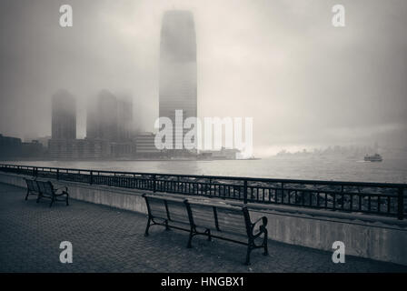 New Jersey and New York City in a foggy day viewed from park - Stock Photo