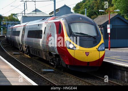 Virgin Trains Class 390 Pendolino 390 121 'Virgin Dream' at Oxenholme Station, Cumbria, England, United Kingdom, - Stock Photo