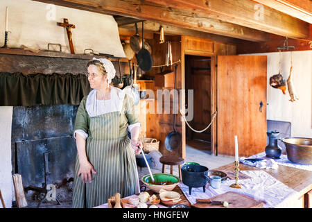Woman in periodic costume at Fortress of Louisbourg, Louisbourg National Historic Site, Nova Scotia, Canada - Stock Photo