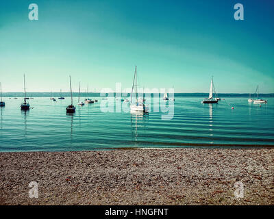 Bavarian Ammersee with boats on the lake as background - Stock Photo