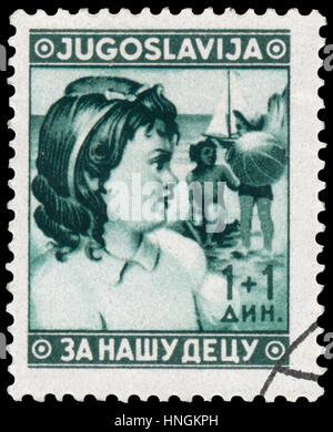 BUDAPEST, HUNGARY - 27 february 2016: stamp printed in Yugoslavia, shows children, circa 1940 - Stock Photo
