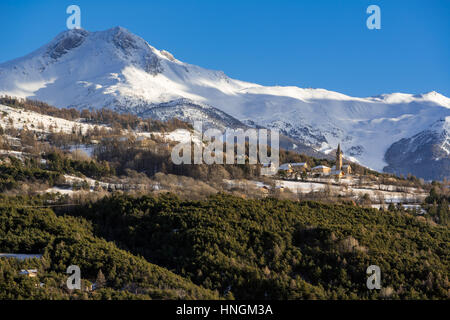 Saint-Sauveur village near Embrun with winter view on Les Orres ski resort. Hautes-Alpes, Southern French Alps, - Stock Photo