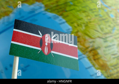 Kenya flag with a globe map as a background macro - Stock Photo