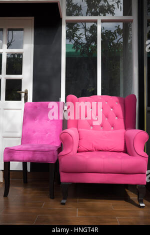 Pink classical style Armchair sofa couch in vintage room Stock Photo ...