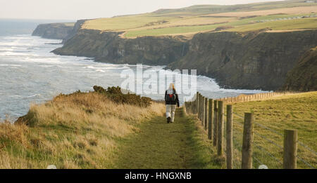 Walker on the coastal path, the Cleveland way in North Yorkshire, England, UK. - Stock Photo